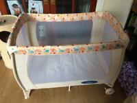 Travel cot with bassinet and changing table