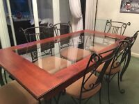 Dining table and 6 chairs with matching unit.