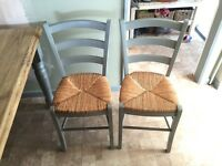 Farmhouse style kitchen dining table with two chairs and bench seat