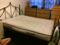 Black metal double bed and mattress