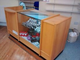 Shop fittings including shelves and counter plus pavement signs bed fireplace and fridge