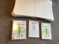 Wii fit board in original box with game and brochures