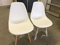 Two stylish white chairs hardly used