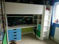 Ikea Stuva cabin bed with desk and storage.