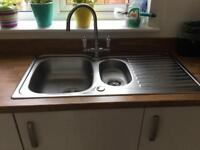 Kitchen sink complete with taps