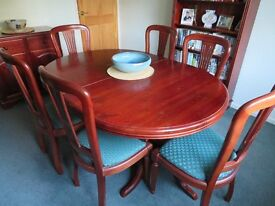 Extending pine dining table (dark finish) and 6 chairs