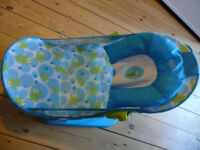 Baby bath seat, bright blue, two angles, easy to fold away, rests in normal bath