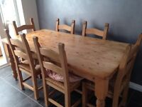 Solid Pine table and 6 chairs in very good condition.
