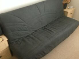 Clic Clac Sofa bed in very good condition in charcoal. Storage capacity in base. Buyer to collect.