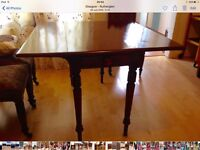Small Pembroke, mahogany, drop leaf table. Highly polished, with front drawer and turned legs.