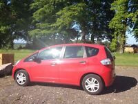 Honda Jazz 1.2 for sale - low mileage (50200 miles) and full service history. Red, 5 doors.