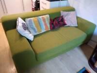 Green two-seater sofas