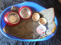 A STURDY PLASTIC DOG BED WITH MATTRESS, FIVEBOWLS, FOUR RUGS, AND A RAIN JACKET