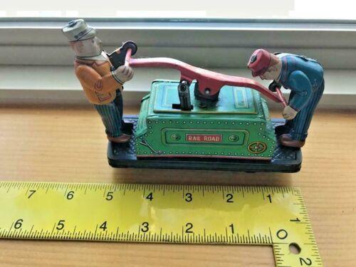 Rail Road Pump Jack Tin Toy
