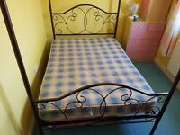 4 Poster metal double bed - sprung slatted base (Mattress avail. no extra cost if required).