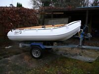 Whaly 270 rowing/motor dinghy and road trailer. New 2013 - excellent condition. Includes oars