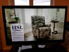 37inc LG led tv with black glass stand with remote and manual