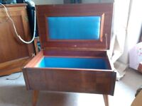 vintage sewing/storage/coffee table needs some TLC on the top, otherwise in good condition