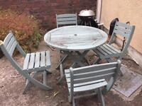 Outside table and four chairs