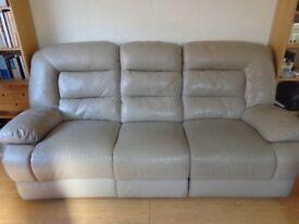 Leather three seat electric recliner sofa. Taupe/mushroom colour.