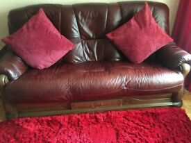 2 x Dark Red Leather sofas with wooden trim and drawer storage