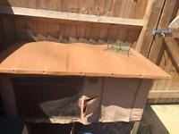 Rabbit hutch with cover