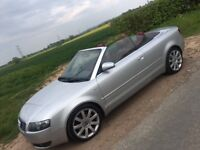 Audi A4 convertible. Silver with red roof.