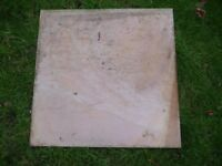 square polished stone slabs 29 cm- that were bought but not needed. a few are slightly muddy