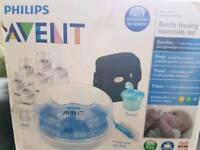 Brand new bottles and microwave steriliser set