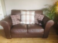 Lovely leather 2 seater sofa from Harveys. Excellent condition.