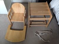 solid wood highchair which can also be used as a table and chair
