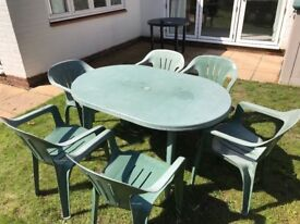 Green Plastic Table and Six Chairs
