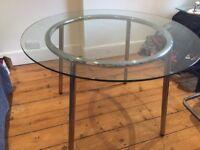 Glass top table -Ikea Salmi- removable chrome legs, good condition; 73cm high, 105cm diameter
