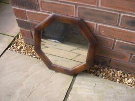 A small vintage octagonal mirror.