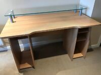 Wooden desk with glass monitor shelf