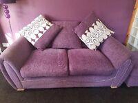 Purple sofa and foot stool