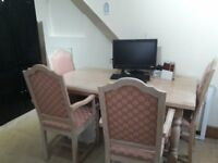 Used Dining table and chairs - table marked
