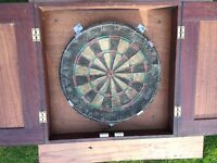 Professional Vintage Nordor dart board in wall mounted mahogany cabinet