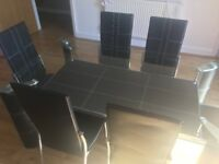 Black & glass dining table and 6 chairs