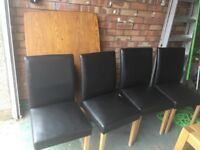 Solid wood table and 4 x faux leather chairs