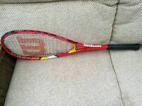 Squash raquet and 2 balls