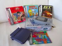 Boxed Nintendo Gameboy Advance Clear Blue Console with 4 games, magnifying screen. Excellent cond.