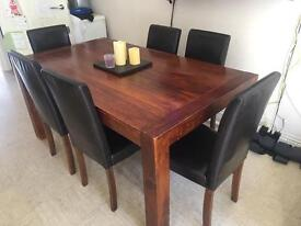 Large solid wood table and 6 chairs