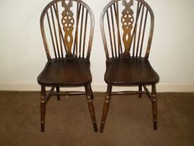 Pair of dark wood dining chairs in good condition