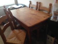 Solid pine table + 4 chairs size 4ft x 2ft 9in good condition / buyer collects. £125