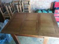 Solid oak dining table - seats 6