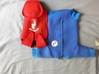 Two bare feet baby wetsuit and swim wrap