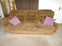 Three piece brown suite. Consist of Settee, one standard chair & one swivel chair.
