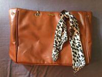 Brown Prada Handbag includes matching purse/make-up bag