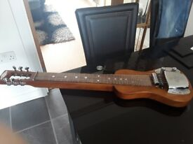 SX Electric steel guitar with bag.